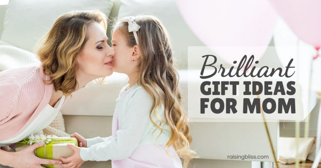 Girl kisses her mom and gives her a gift box