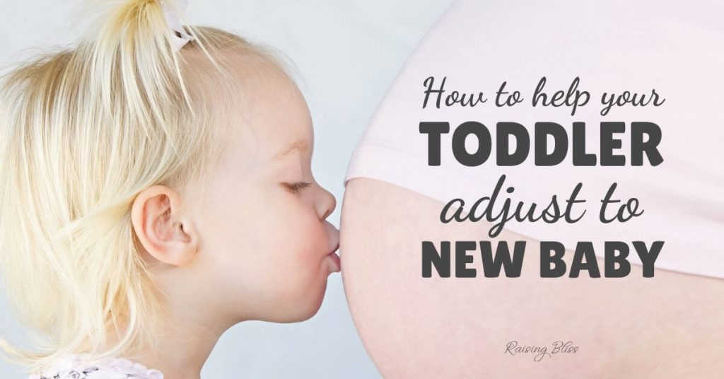 Little girl kissing mommy's belly - How to help your toddler adjust to new baby by Raising Bliss