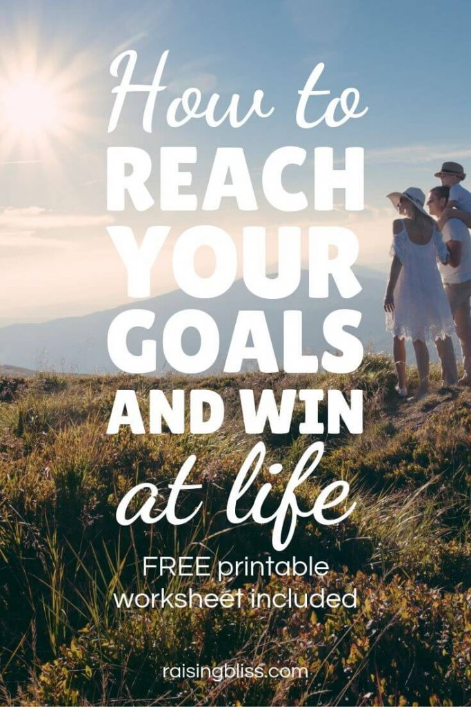 Family looking out on mountains with sun shining down - How to reach your goals and win at life by Raising Bliss