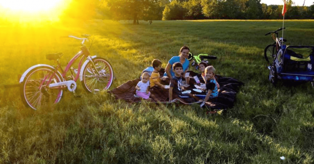 Raising Bliss family on a picnic with bicycles