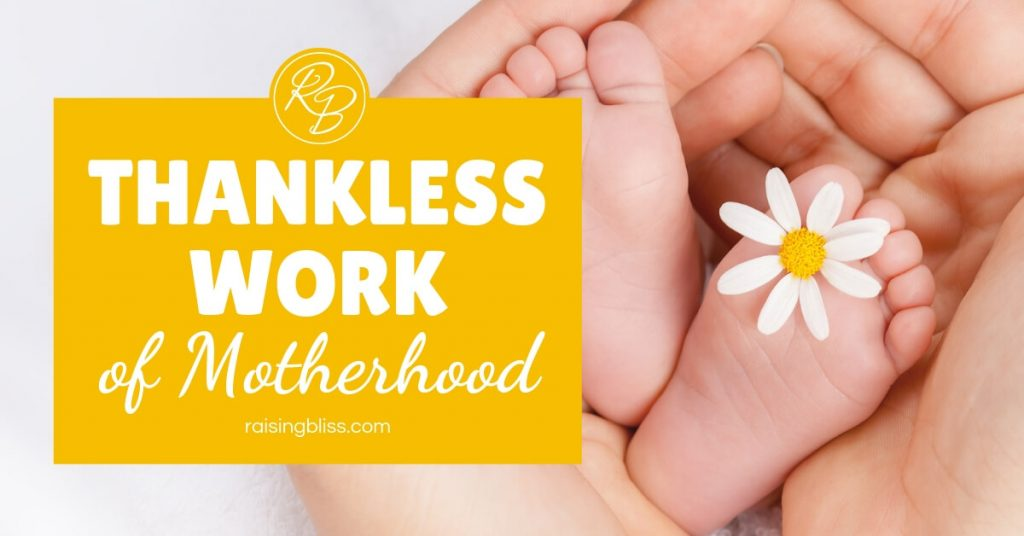 Thankless Work of Motherhood by Raising Bliss Baby Feet in mother's hands with daisy