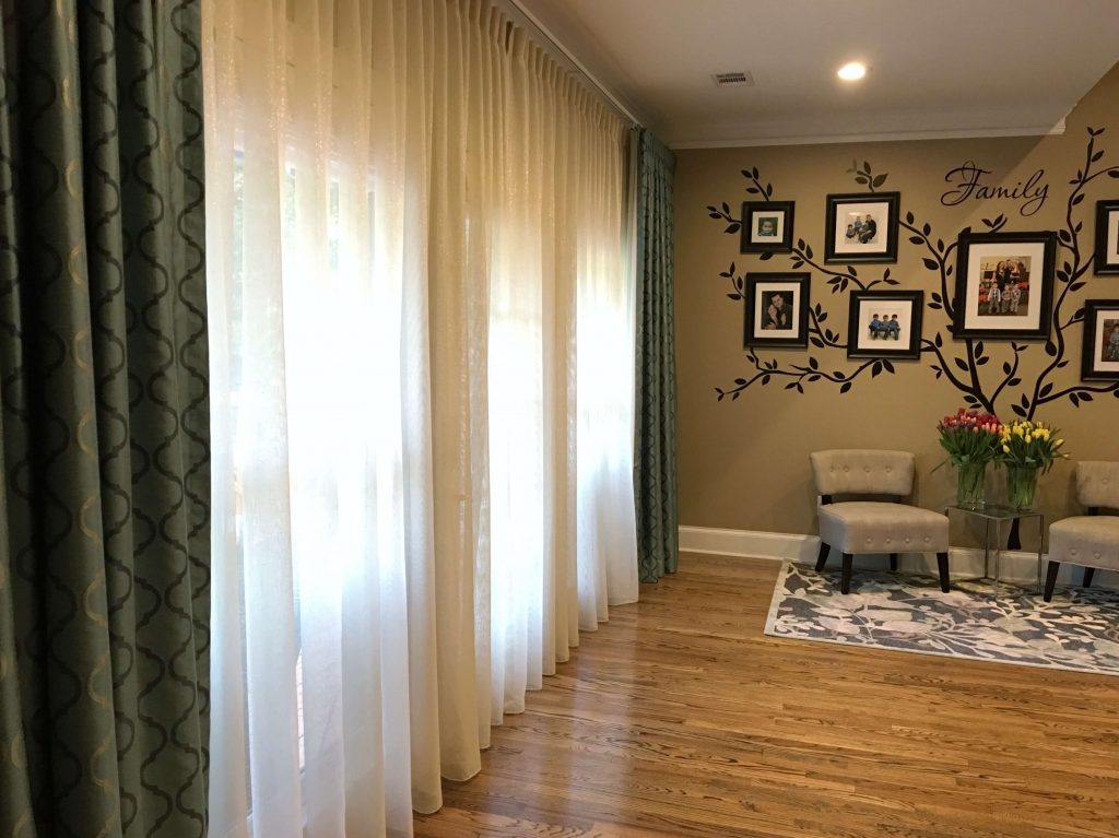 Wall of windows next to a family tree wall - How to make a family tree wall in 5 easy steps by raising bliss